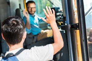 School bus driver waving